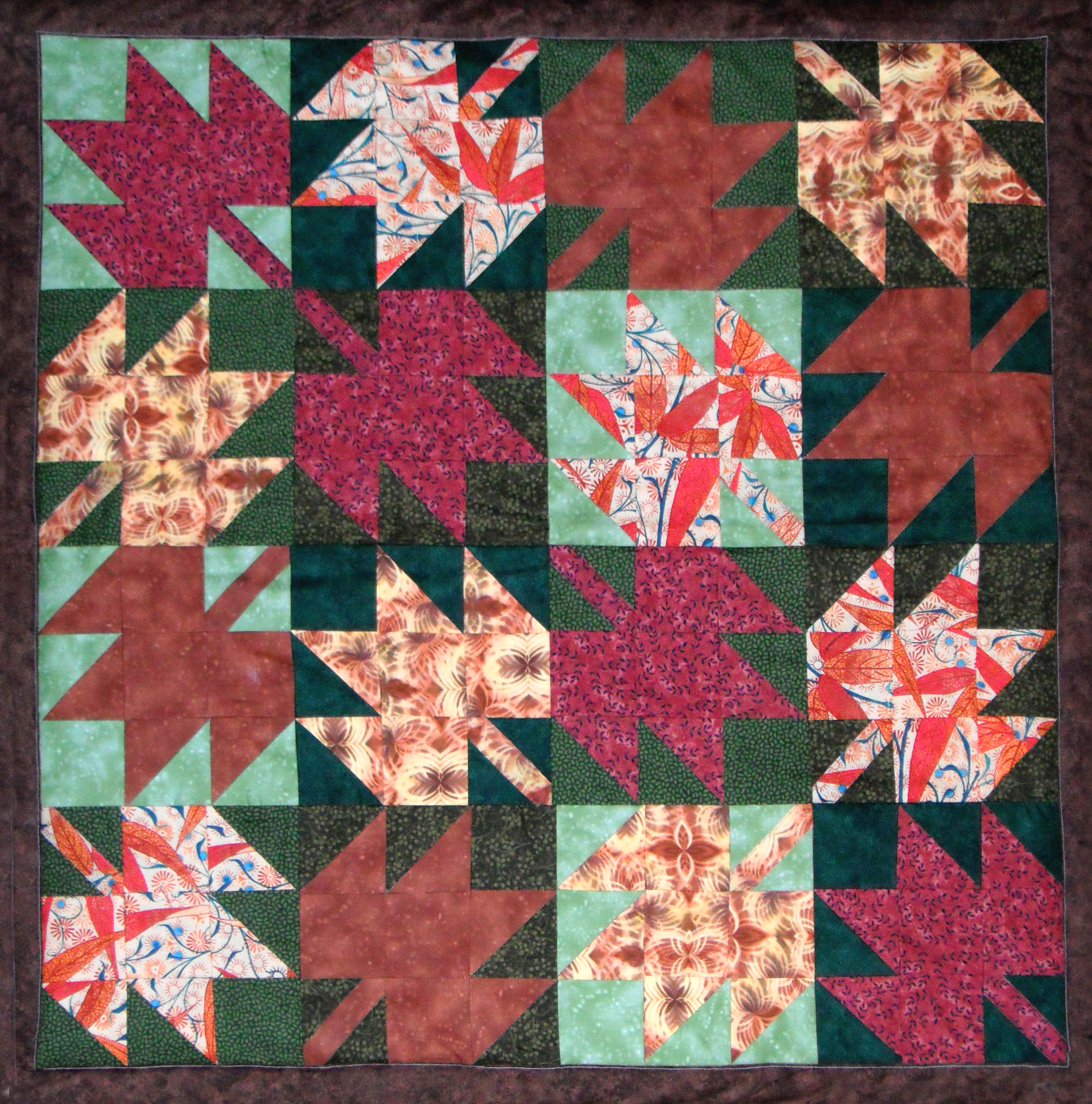 Lap quilt made using 16 maple leaf blocks